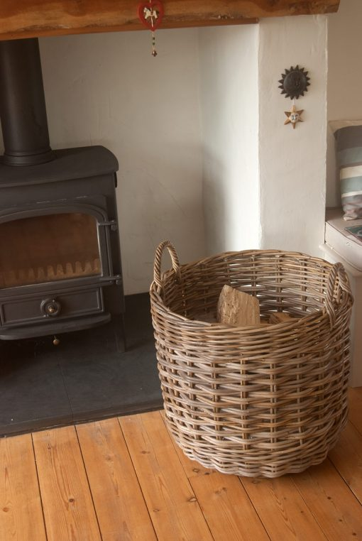 grey wicker fireside log storage