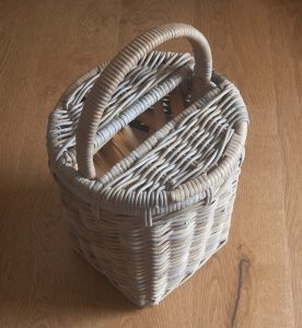 grey wicker kindling basket